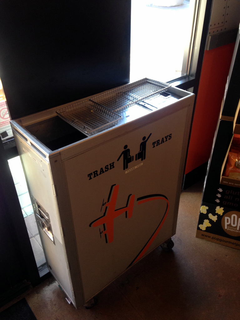trash can made out of a airplane beverage cart